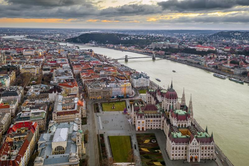 Budapest, Hungary - Aerial view of the Parliament of Hungary with Szechenyi Chain Bridge, Buda Castle Royal Palace. Kossuth Square and Citadel at background at stock images