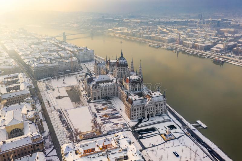 Budapest, Hungary - Aerial view of the snowy Parliament of Hungary by River Danube on a foggy winter morning royalty free stock photos
