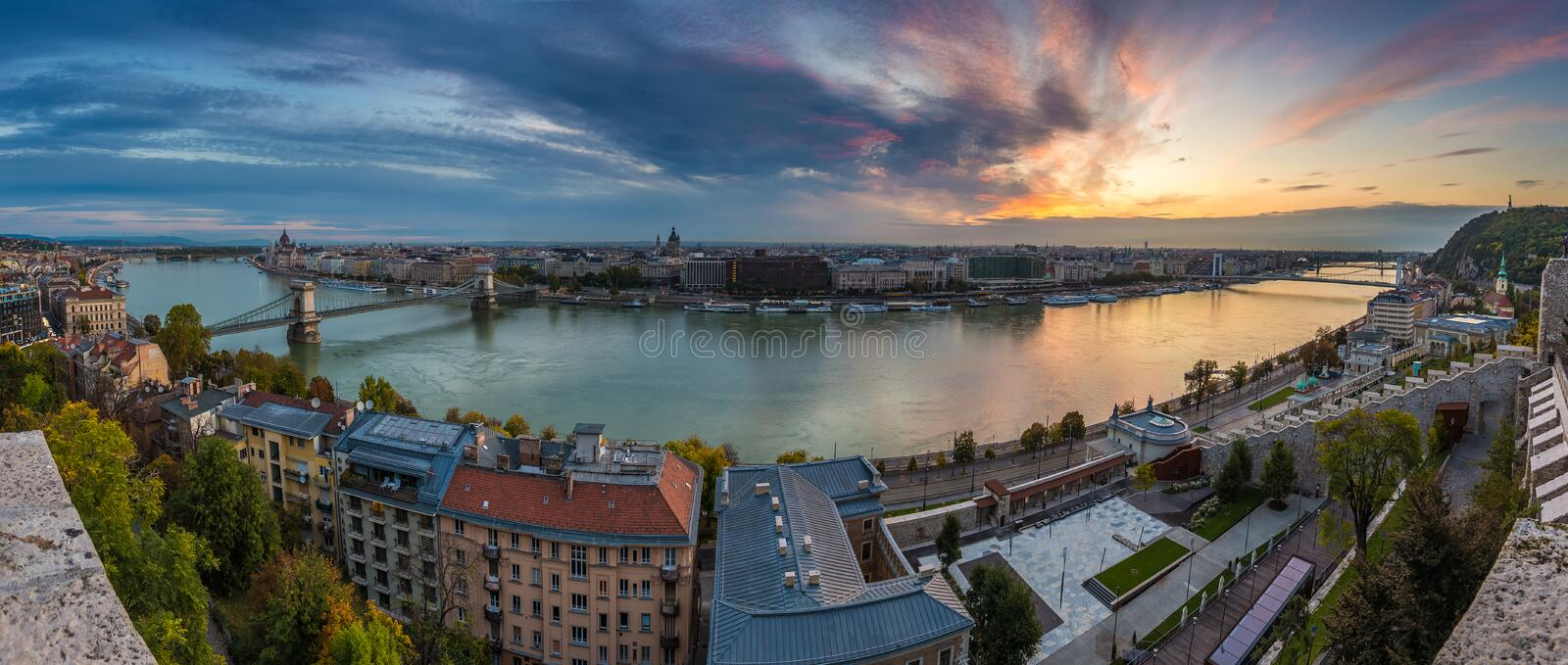 Budapest, Hungary - Amazing colorful sunrise over the city of Budapest with Szechenyi Chain Bridge. Liberty Bridge and other landmarks taken from Buda Castle stock image