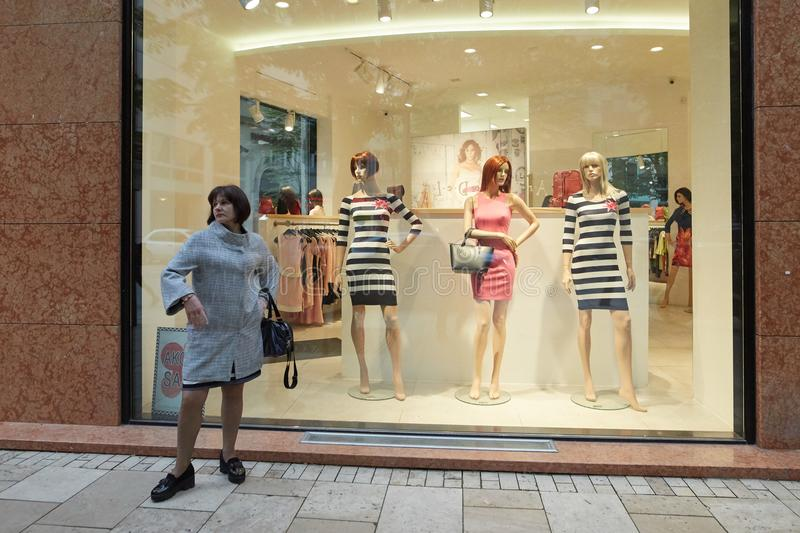 Budapest, Hungary - 17 April 2018: the girl is standing by the shop window. stock image