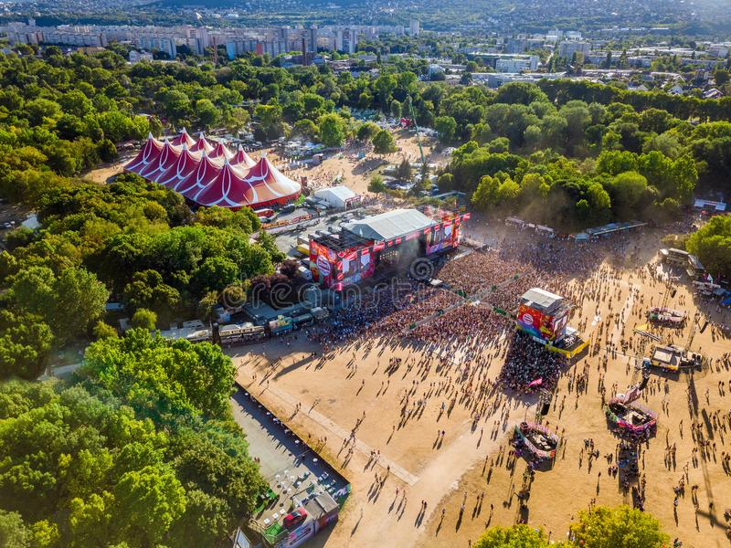BUDAPEST, HUNGARY - AUGUST 12, 2018: Aerial photograph of the crowd in front of the main stage of the Sziget Festival at sunset. Sziget Festival is the biggest royalty free stock photography