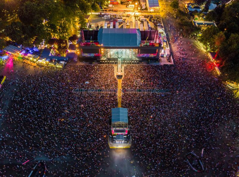 BUDAPEST, HUNGARY - AUGUST 12, 2018: Aerial photograph of the main stage and the massive crowd of the Sziget Festival 2018. By night. Sziget Festival is the stock images