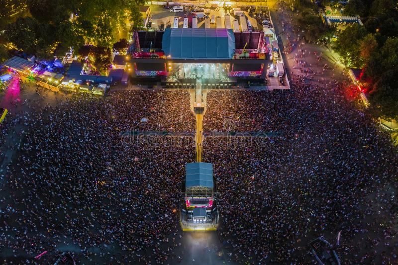BUDAPEST, HUNGARY - AUGUST 12, 2018: Aerial photograph of the main stage and the massive crowd of the Sziget Festival 2018. By night. Sziget Festival is the royalty free stock image