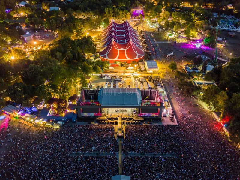 BUDAPEST, HUNGARY - AUGUST 12, 2018: Aerial view of Sziget Festival 2018 and main stage at dusk. Sziget Festival is the biggest music festival in Europe royalty free stock photos
