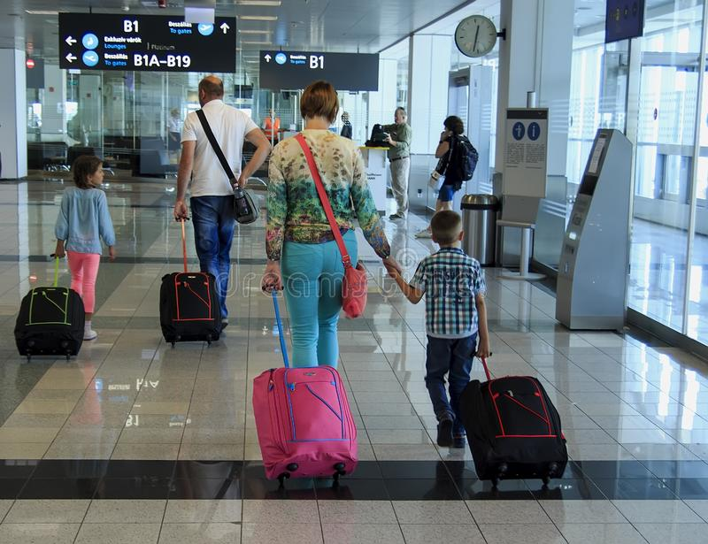 Budapest, Hungary - August 19, 2017: Family with suitcases at the airport stock photography