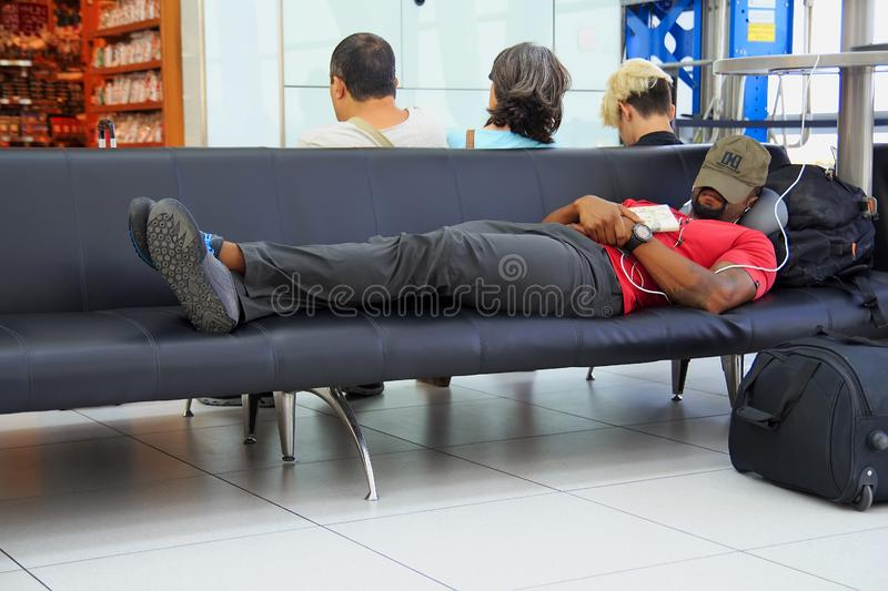 Budapest, Hungary - August 19, 2017: Man is waiting for his flight at the airport stock image
