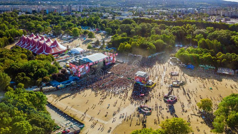 BUDAPEST, HUNGARY - AUGUST 12, 2018: Panoramic aerial photograph of the crowd in front of the main stage of the Sziget Festival. At sunset. Sziget Festival is stock photography