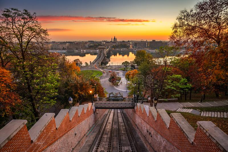 Budapest, Hungary - Autumn in Budapest. The Castle Hill Funicular Budavári Siklo with the Szechenyi Chain Bridge. And St. Stephen`s Basilica at sunrise with royalty free stock image