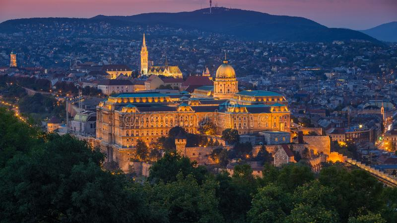 Budapest, Hungary - The beautiful Buda Castle Royal Palace and Matthias Church at magic hour. With colorful sky stock photo