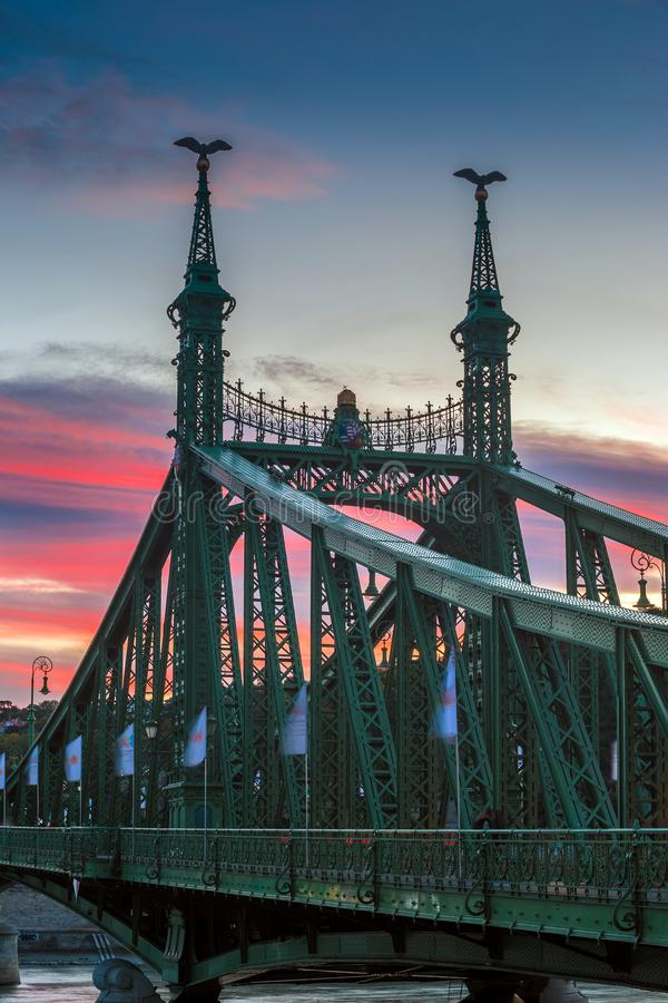 Budapest, Hungary - The beautiful Liberty Bridge at suset with amazing colorful sky. And clouds stock photo
