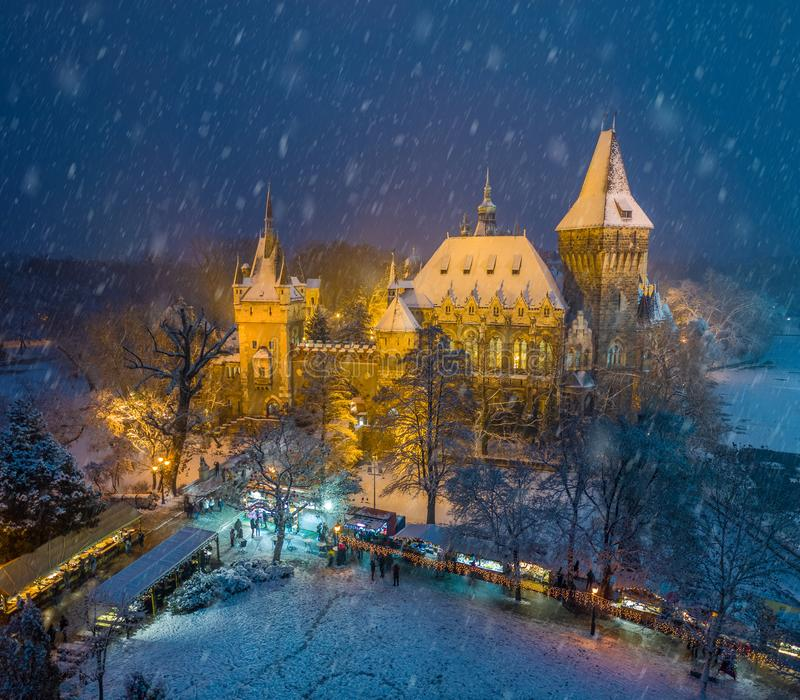 Budapest, Hungary - Christmas market in snowy City Park Varosliget from above at night with snowy trees royalty free stock image