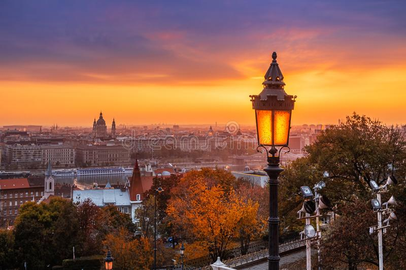 Budapest, Hungary - Colorful autumn morning at Budapest. Street lamp at the Fisherman`s Bastion, St. Stephen`s Basilica. And amazing golden sunrise at the royalty free stock images