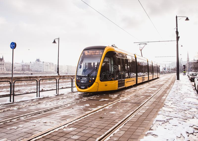 BUDAPEST, HUNGARY - DECEMBER 16, 2018: Yellow trams near the embankment on the Buda side in Budapest. Hungary stock photography