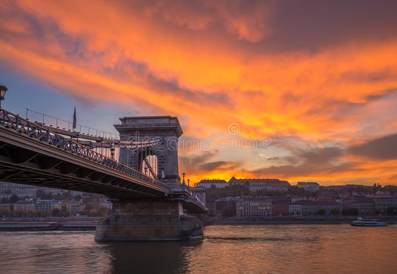 Budapest, Hungary - Dramatic orange sunset with beautiful clouds, Szechenyi Chain Bridge royalty free stock photos