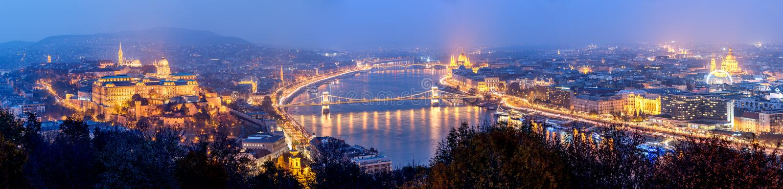Budapest, Hungary, Europe - Panorama. Panoramic view of Budapest, the capital city of Hungary. Night view of the Buda Castle, Parliament Building, bridges over royalty free stock photos