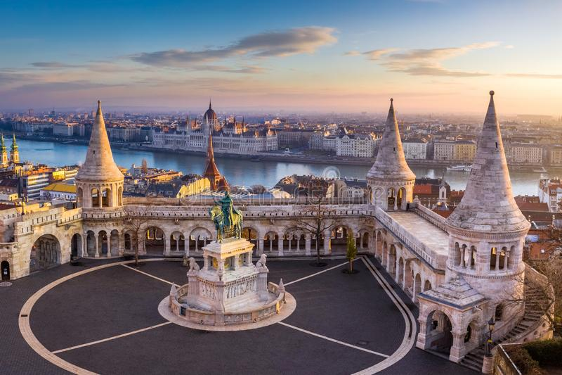 Budapest, Hungary - The famous Fisherman`s Bastion at sunrise with statue of King Stephen I and Parliament of Hungary royalty free stock images