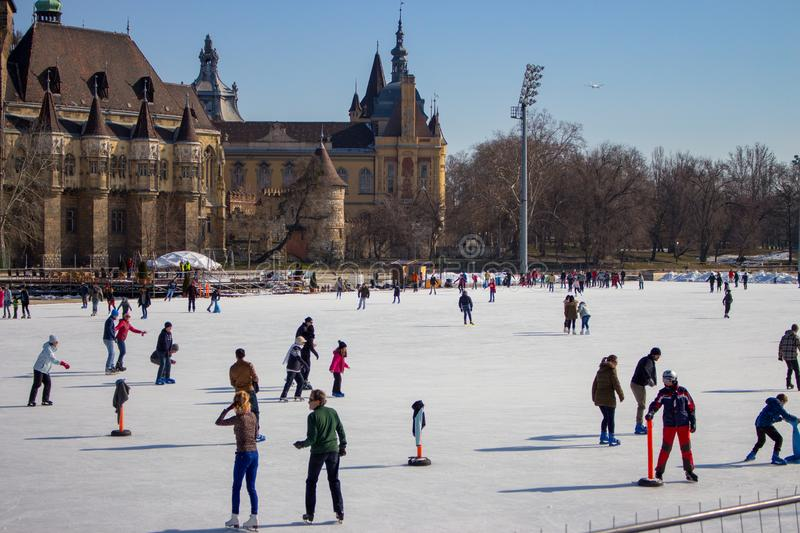 Budapest, Hungary - 20/02/2018: famous ice skating rink with people. Frozen lake with skaters. Winter activity and fun concept. royalty free stock photography