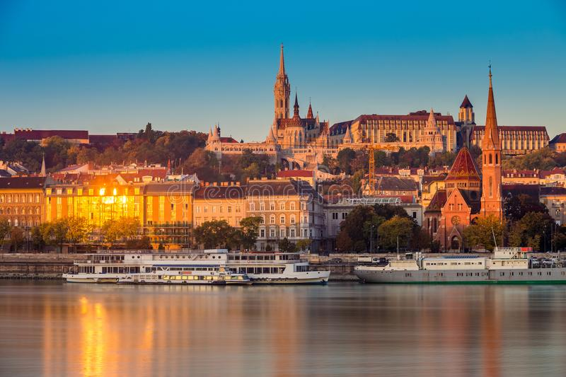 Budapest, Hungary - Golden hour in the morning at Buda side with the Buda Castle, St. Matthias church. And the Fisherman`s Bastion with old ships on River stock photo