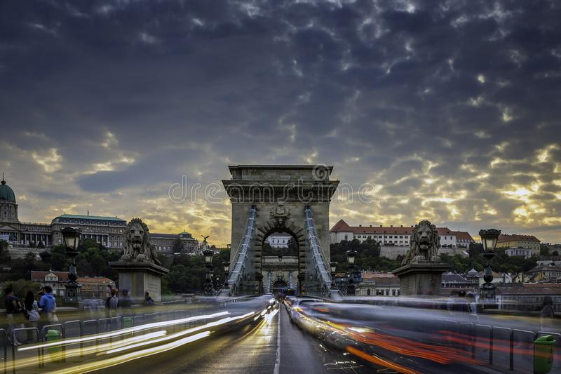 Budapest, Hungary - Heavy afternoon traffic on the iconic Szechenyi Chain Bridge at sunset. With beautiful sky and clouds royalty free stock images