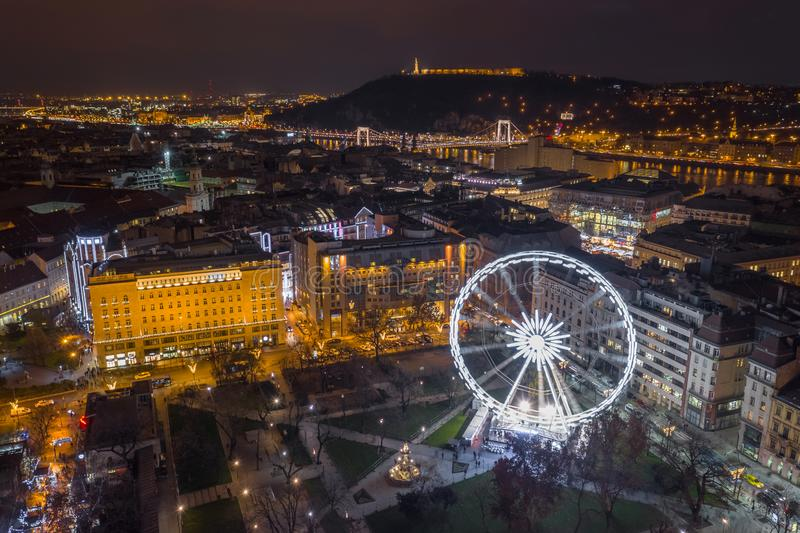 Budapest, Hungary - Illuminated ferris wheel at Elisabeth Square at the centre of Budapest with Statue of Liberty. Elisabeth Bridge and other famous landmarks stock photo