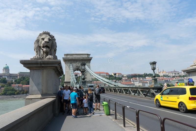 Budapest / Hungary - July 28 2019: The Szechenyi Chain Bridge crossing the Danube River in Budapest. Group of tourist people royalty free stock photo
