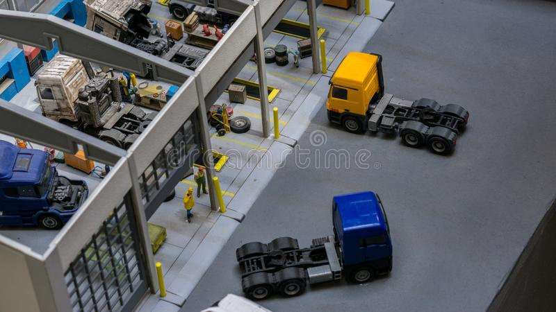 Budapest, Hungary - JUN 01, 2018: Miniversum Museum Exposition - Mini scale of Truck Repair Shop Toys. Miniversum is one of the largest miniature exhibitions in royalty free stock photos