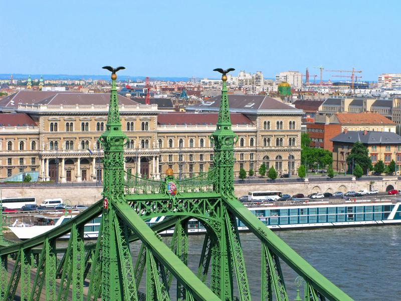 Budapest, Hungary, Liberty bridge, Budapest Corvinus University. Hungary. Pamorama of the Budapest city with the Liberty bridge in the foreground. The top of the royalty free stock images