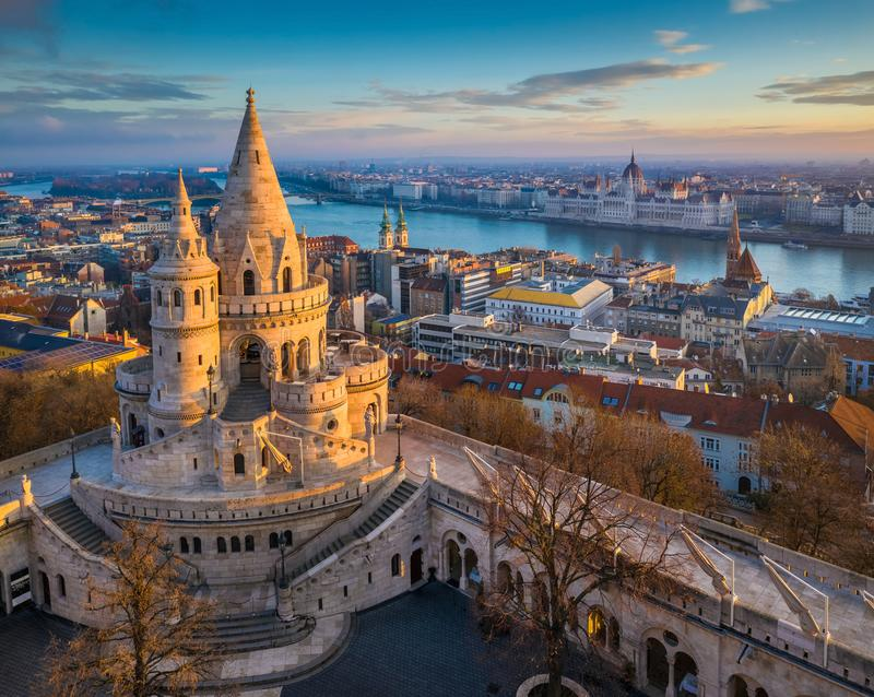 Budapest, Hungary - The main tower of the famous Fisherman`s Bastion Halaszbastya from above. With Parliament building and River Danube at background on a sunny royalty free stock photo