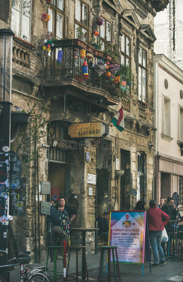 BUDAPEST, HUNGARY - MARCH 26, 2017: Kazinczy Street and ruin pub. BUDAPEST, HUNGARY - MARCH 26, 2017: Kazinczy Street and facade of the most popular ruin pub of royalty free stock photography