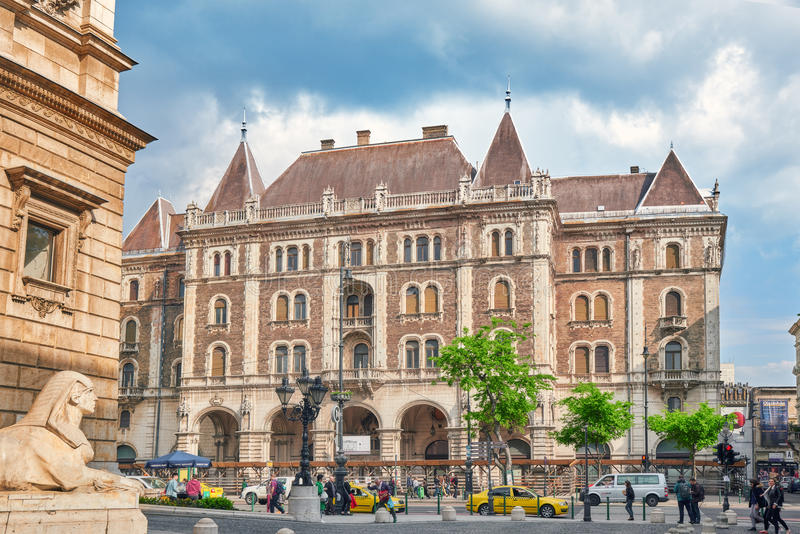BUDAPEST, HUNGARY-MAY 02,2016: Dreschler Palace-gorgeous building in front of the Opera in Budapest. Street view with people. stock image