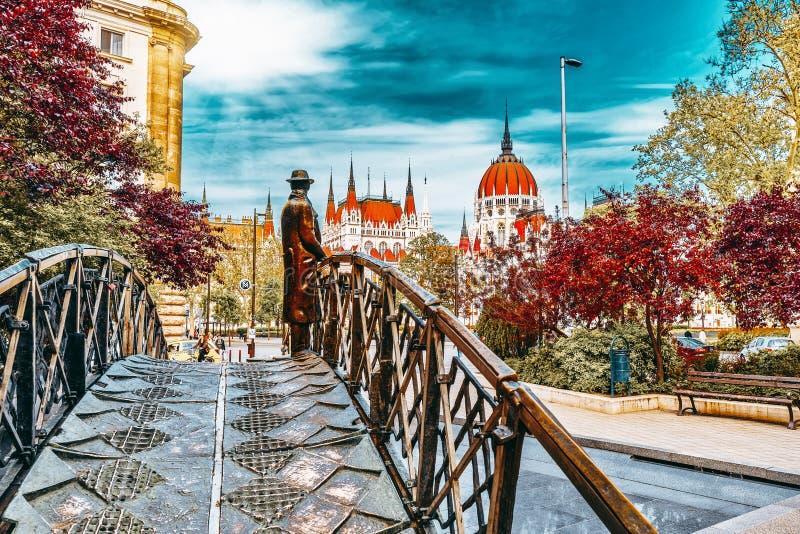 BUDAPEST, HUNGARY -MAY 04, 2016: Statue on Iron Bridge - Monument to Imre Nagy Remembrance Day, on back stage-Hungarian. Parliament . Budapest. Hungary stock photo