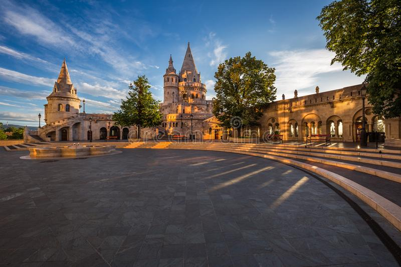 Budapest, Hungary - Morning view of the Fisherman Bastion on top of Buda Hill. With beautiful lights and sky at sunrise stock photo