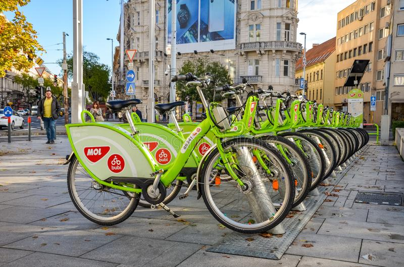 Budapest, Hungary - Nov 6, 2019: Public green bikes for rental in the center of the Hungarian capital. Bike sharing. Eco-friendly stock images