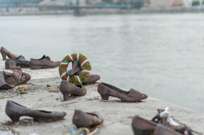 BUDAPEST, HUNGARY - OCTOBER 26, 2015: Shoes on the Danube Bank to honor the Jews who were killed in Budapest during World War II royalty free stock photography