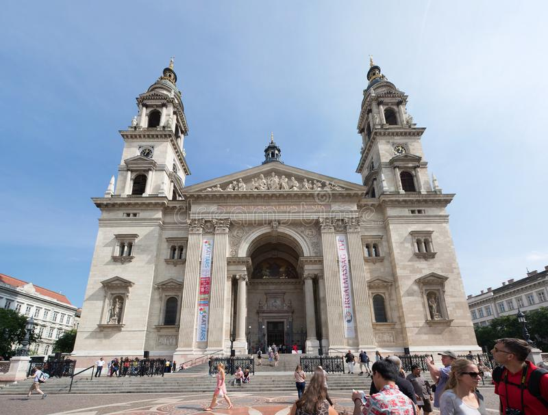BUDAPEST, HUNGARY - SEPTEMBER 16, 2016: People walking in front of historic church - St. Stephen Basilica. It is named in honor of. Stephen (Istvan) - first stock images