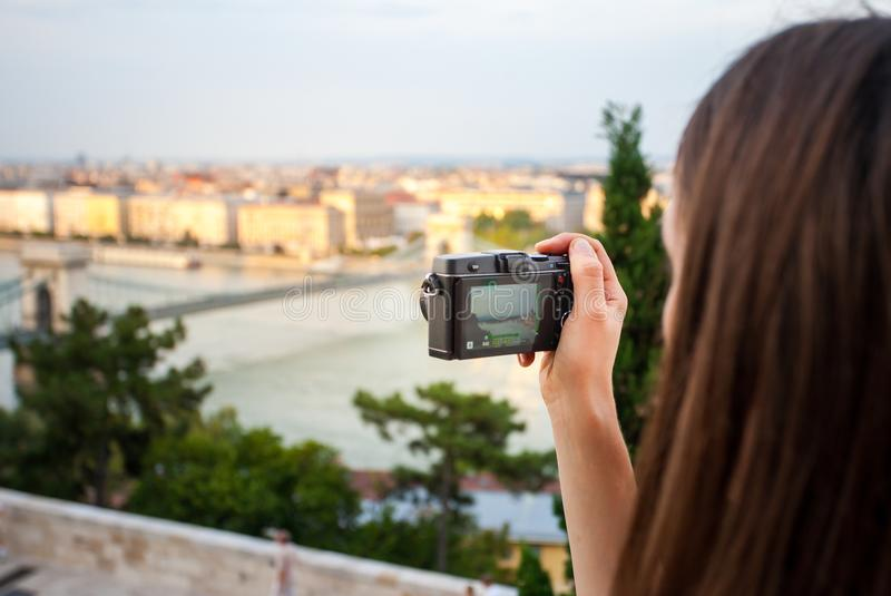 Budapest, HUNGARY - 03 September 2016: Young girl is taking photo of Danube river Landscape. Concept of Europe travel and. Vacations stock photos