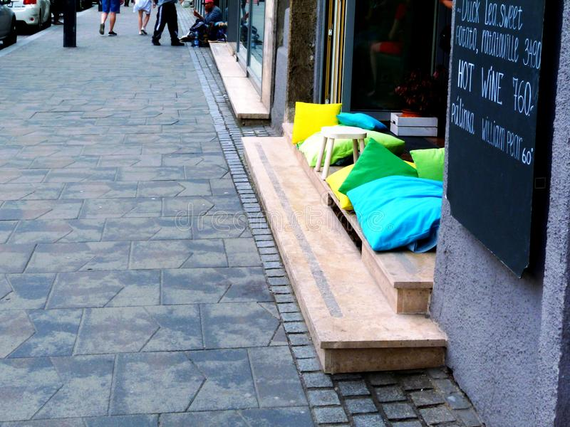 Street scene in Budapest. inviting colorful cushions on stone ledge. stock image