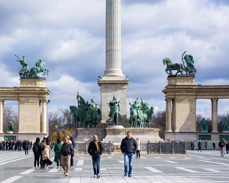 Budapest Hungary 03.15.2019.Three men are walking in the heroes square stock images