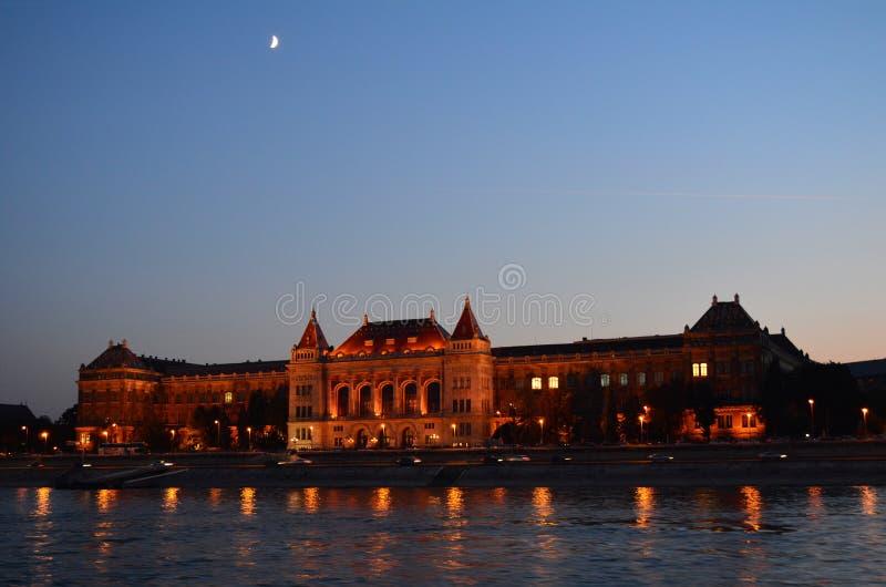 Budapest at Night: The Corvinus University. The Corvinus University of Budapest at Night stock image