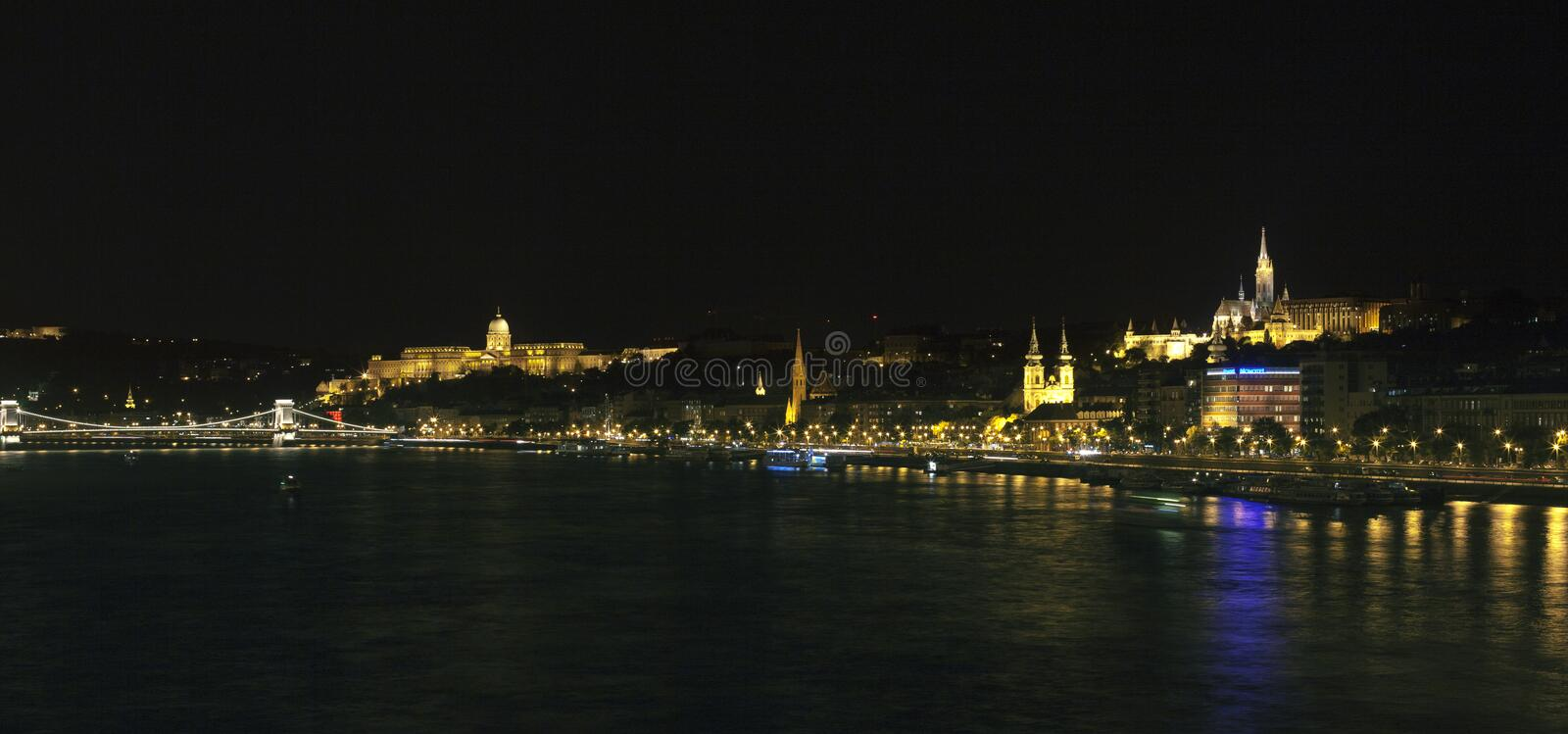 Budapest at night. View of reformed church and chain bridge in Budapest at night royalty free stock photo