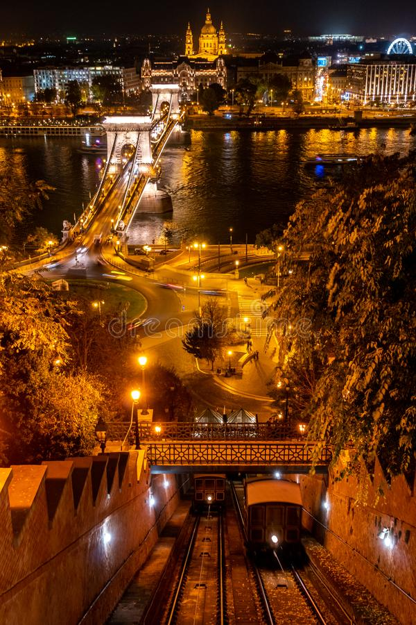 Budapest nightscape, with funicular, Danube river, Chain Bridge, Saint Stephen Church, and Budapest Eye, 2019. stock photos