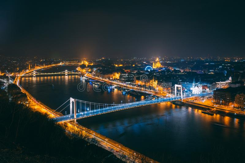 Budapest at Nighttime with the Parliament and with many Bridges. The photo has been taken from the Citadella, a famous spot for tourists stock image