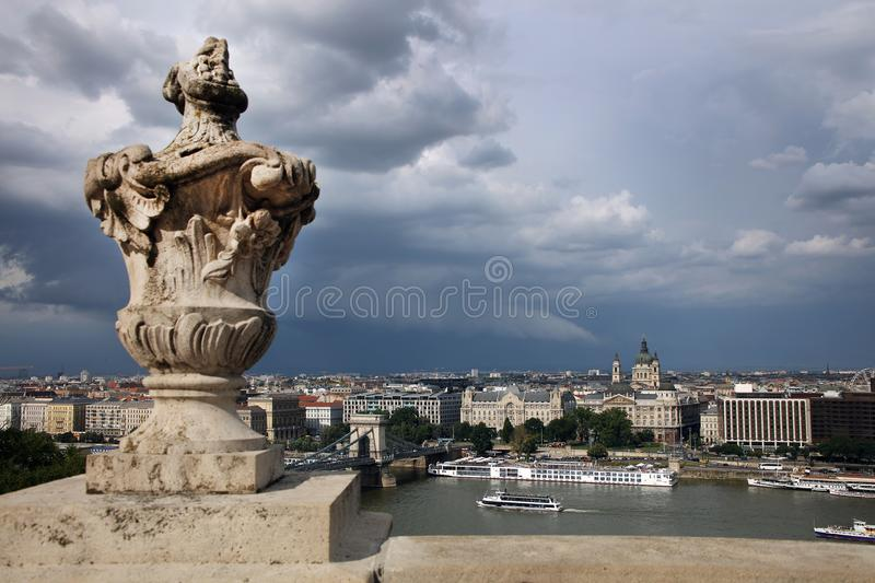 Budapest under storm clouds, seen from Gellert hill. Beautiful historical buildings on the left bank of the Danube river. stock photography