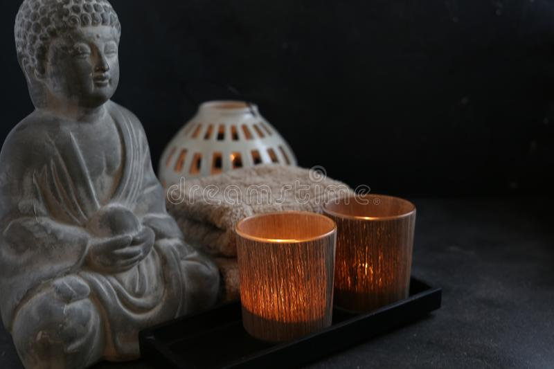 Buddah witn candle and towel spa concept stock photos