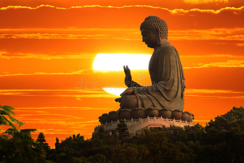 Buddha. Statue sunset sky background