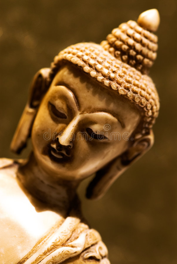 Buddha. An ornate Buddha carving made from limestone stock photography