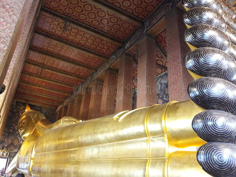 Buddha adagiantesi, Wat Pho fotografia stock