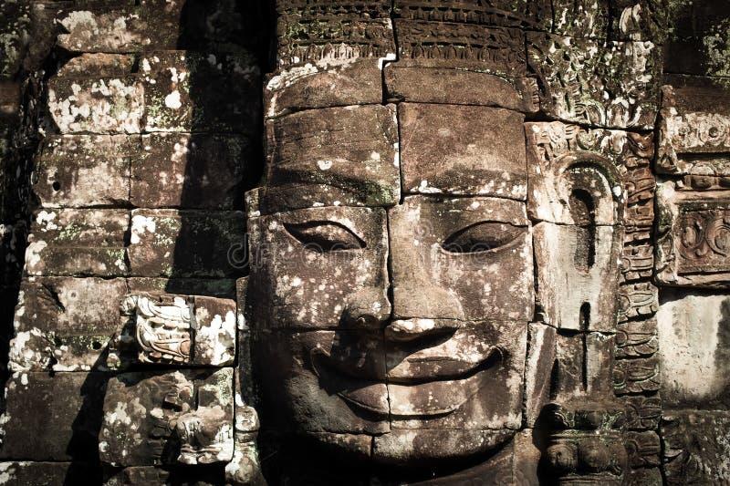 Buddha affronta del tempio di Bayon a Angkor Wat cambodia fotografie stock libere da diritti