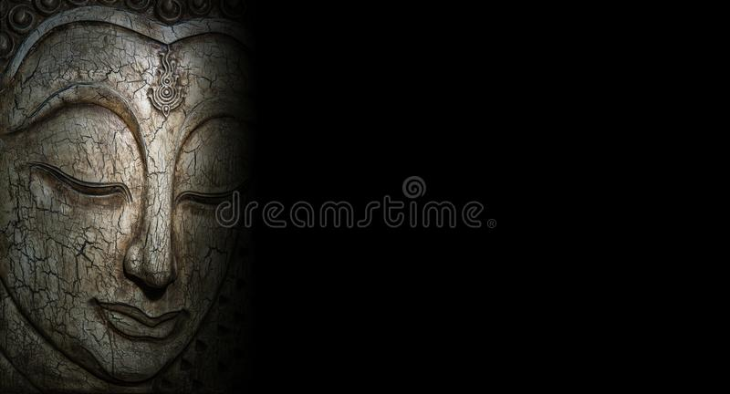 Buddha affronta scolpito da legno fotografia stock libera da diritti