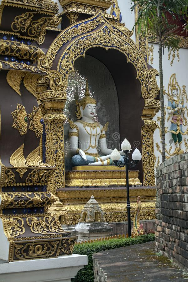 Buddha in an alcove at Wat Saen Muang Ma Luang, Chiang Mai, Thailand. Buddha in a golden alcove at Wat Saen Muang Ma Luang, Chiang Mai, Thailand royalty free stock image